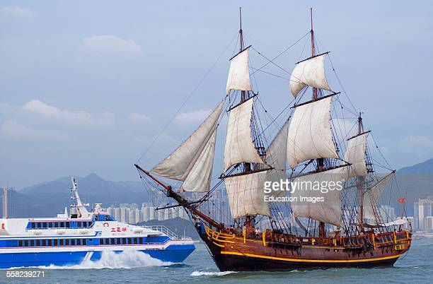 Spanish Galleon and Chinese highspeed ferry Victoria harbor China