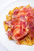 serrano ham potato dish served utrera