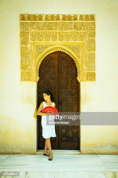 spanish girl with red fan in the alhambra - alhambra spain stock photos and pictures