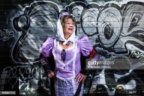 Spanish Gloria dressed in traditional chulapa garb for San Isidro celebrations poses in Madrid on May 15 2018