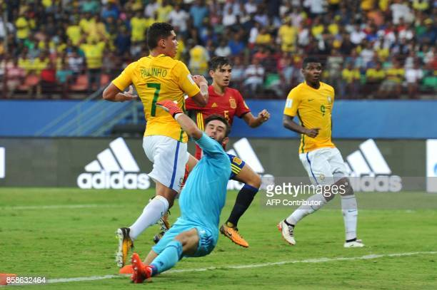 Spanish goalkeeper Alvaro Fernandez fails to stop Brazilian footballer Paulinho of Brazil from scoring a goal during their group stage football match...