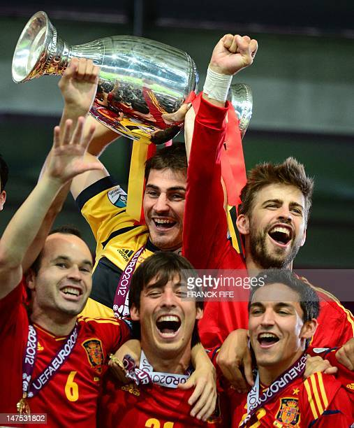 Spanish goalkeeper and captain Iker Casillas holds the trophy and celebrate with team mates after winning the Euro 2012 football championships final...