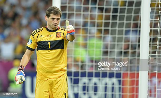 a6dcb5f61e3 Spanish goalkeeper Iker Casillas gestures during the Euro 2012 football  championships final match Spain vs Italy