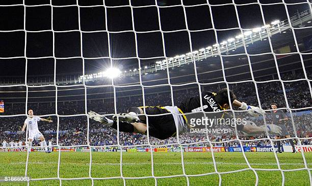 Spanish goalkeeper Iker Casillas saves a shot by Italian midfielder Daniele De Rossi during the penalty shoot-outs at the Euro 2008 Championships...