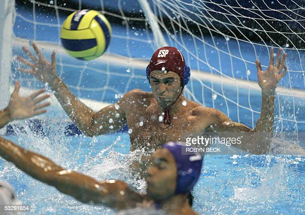 Spanish goalkeeper Inaki Aguilar misses a shot on goal by Hungary during their quarterfinal match 26 July 2005 at the XI FINA Swimming World...