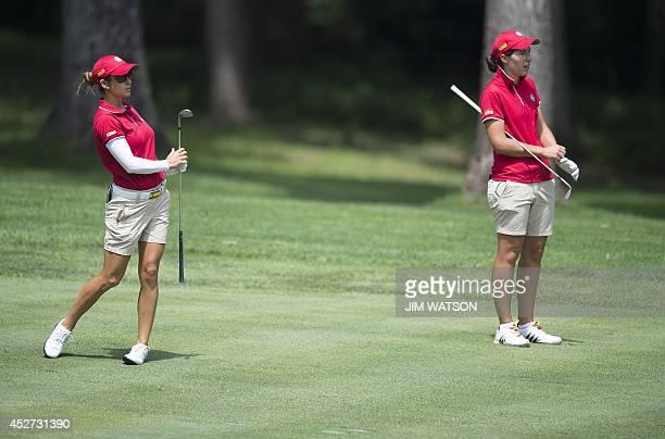 Spanish golfer Azahara Munoz and her partner Carlotta Ciganda watch her shot from the fairway during the third round of the LGPA International Crown...