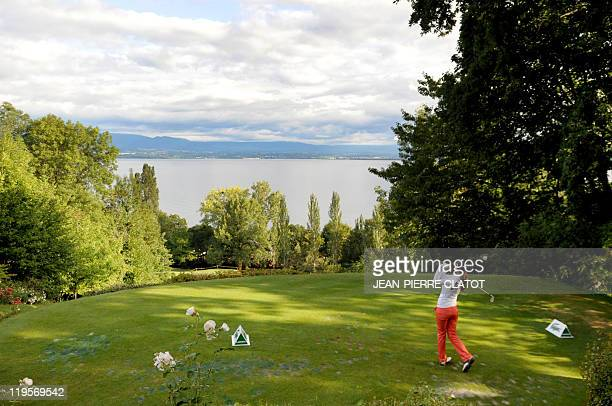 Spanish golfer Azahara Munoz hits a drive during the Evian Masters Golf Tournament on July 22 2011 in EvianlesBains French Alps Sweden's Maria Hjorth...