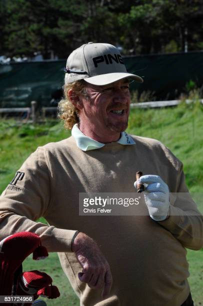 Spanish golfer Miguel Angel Jimenez smokes a cigar as he leans on his golf bag during the 110th US Open golf championship Pebble Beach California...