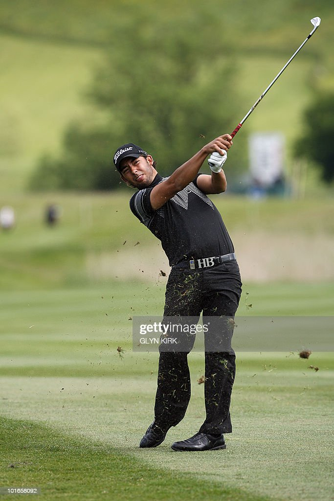 Spanish golfer Pablo Larrazabal plays his approach shot to the 12th green during the final round of the Celtic Manor Wales Open on The Twenty Ten Course in Newport, Wales on June 6, 2010.