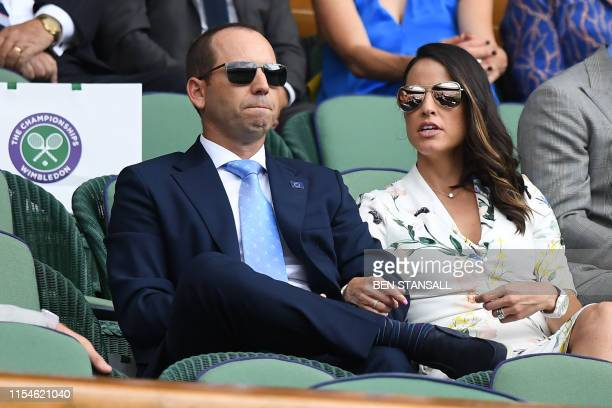 Spanish golfer Sergio Garcia and his wife Angela Akins watch Spain's Rafael Nadal playing Portugal's Joao Sousa during their men's singles fourth...