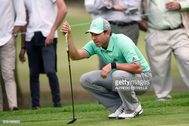 Spanish golfer Sergio Garcia eyes his ball at the 14th green, during the second round of the World Golf Championship in Mexico City, on March 2,...