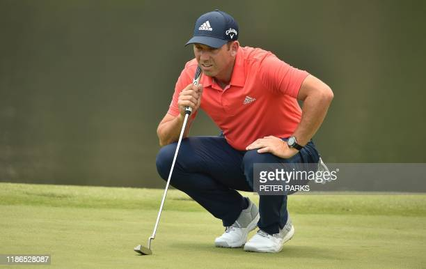 Spanish golfer Sergio Garcia lines up a putt at the 3rd hole on day one of the Australian Open golf tournament in Sydney on December 5, 2019. / --...