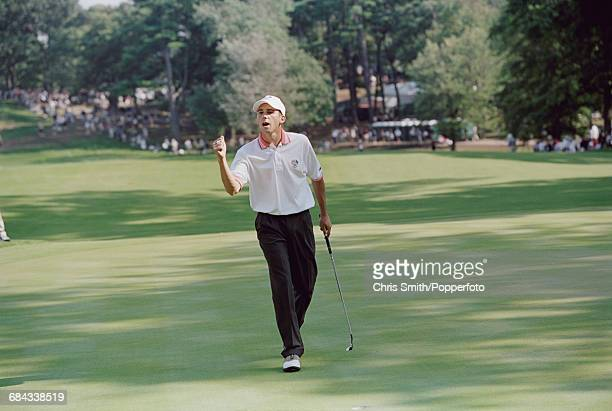 Spanish golfer Sergio Garcia pictured celebrating after a successful putt on a green for Team Europe during play to lose to Team USA in the 1999...