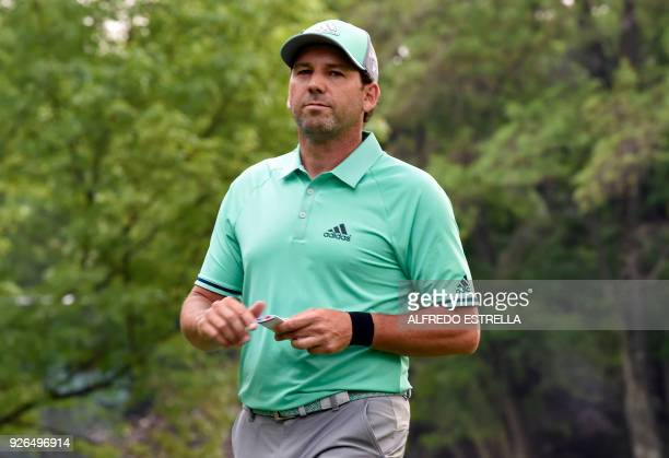 Spanish golfer Sergio Garcia walks off the 15th tee, during the second round of the World Golf Championship in Mexico City, on March 2, 2018. / AFP...