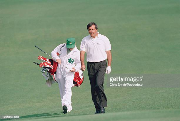 Spanish golfer Seve Ballesteros pictured walking down a fairway with his caddy during competition in the 1992 Masters Tournament at Augusta National...