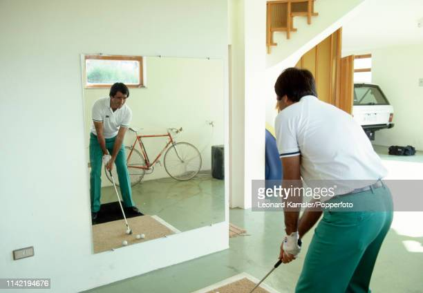 Spanish golfer Seve Ballesteros practicing in front of a mirror at his home in Spain circa 1986