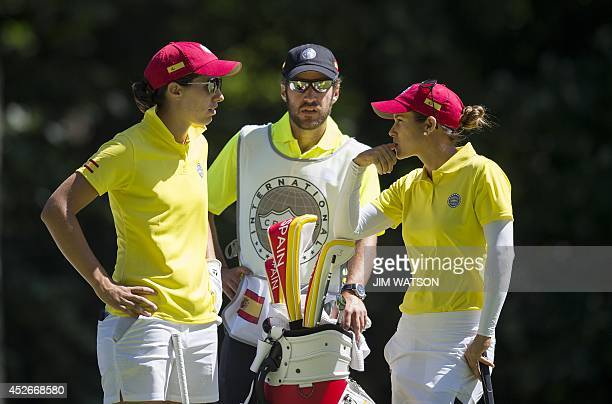 Spanish golfers Carlotta Ciganda and Azahara Munoz talk with their caddie during the second round of the LGPA International Crown at Caves Valley...