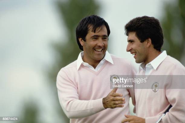Spanish golfers Severiano Ballesteros and Jose Maria Olazabal shaking hands during a Ryder Cup match at The Belfry, Warwickshire, 22nd September...