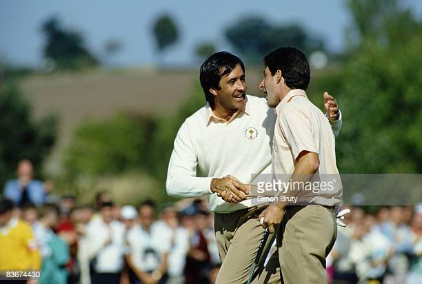 Spanish golfers Severiano Ballesteros and Jose Maria Olazabal shaking hands during a Ryder Cup match at The Belfry, Warwickshire, 24th September...