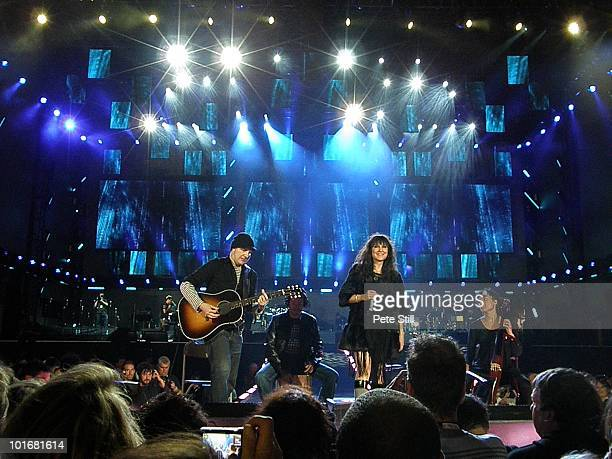 Spanish group Amaral including guitarist Juan Aguirre and singer Eva Amaral perform on stage at the 46664 concert in honour of Nelson Mandela's 90th...