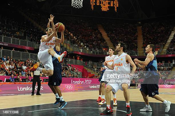 Spanish guard Jose Calderon jumps to score during the men's preliminary round basketball match Spain vs Britain of the London 2012 Olympic Games on...