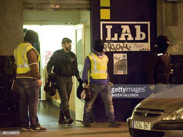 Spanish Guardia Civil carry some bags seized during a search at an office of LAB nationalist trade union during a police operation dubbed 'Mate'...
