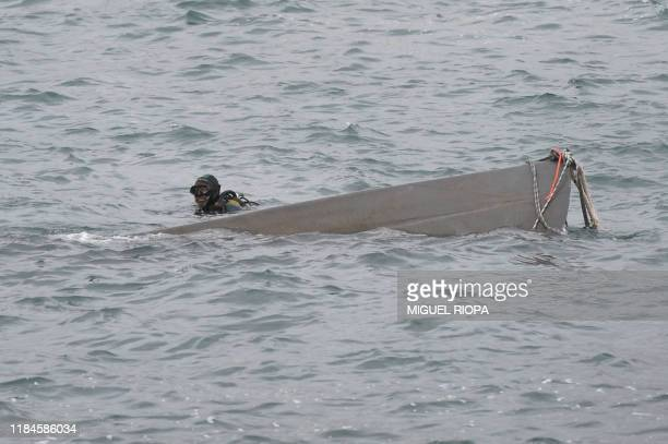 A Spanish Guardia Civil diver works to refloat a submarine used to transport drugs illegally in Aldan northwestern Spain on November 25 2019 Police...