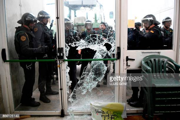 Spanish Guardia Civil guards brake the door of a polling station in Sant Julia de Ramis where Catalan president is supposed to vote on October 1 on...