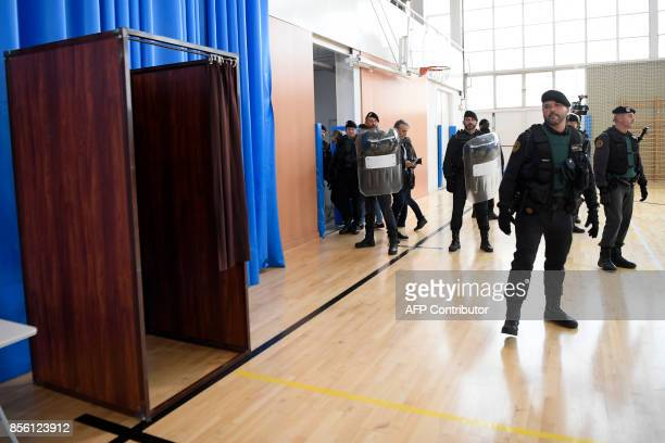 Spanish Guardia Civil guards enter a polling station in Sant Julia de Ramis where Catalan president is supposed to vote on October 1 on the day of a...