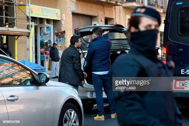 Spanish Guardia Civil members in plainclothes leave the Catalan National Assembly building in Barcelona after searching the premises on January 24...