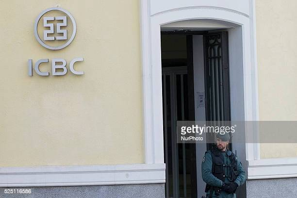 Spanish Guardia Civil stand guard outside the Madrid branch of China's biggest lender ICBC after its director and a deputy director were arrested as...