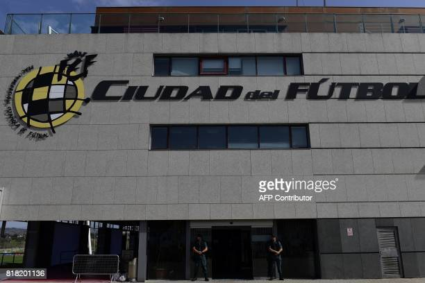 Spanish Guardia Civil stand outsite the Spanish football federation headquarters in Madrid on July 18 2017 during a raid related to the probe said...