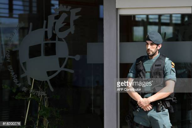 A Spanish Guardia Civil stands outsite the Spanish football federation headquarters in Madrid on July 18 2017 during a raid related to the probe said...