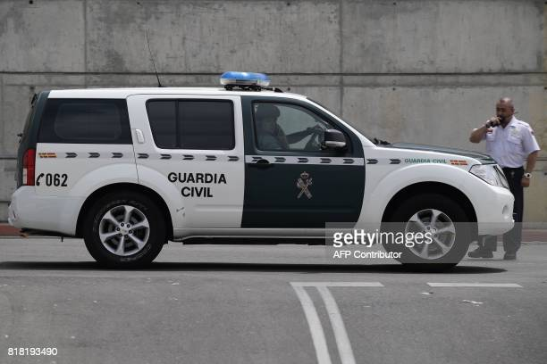 A Spanish Guardia Civil vehicles arrives to the Spanish football federation headquarters in Madrid on July 18 2017 during a raid related to the probe...