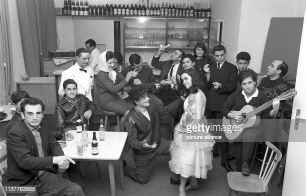 Spanish guest workers dance flamenco and make music during a small preceding party on 11 December 1963 before the actual opening of the Centro...