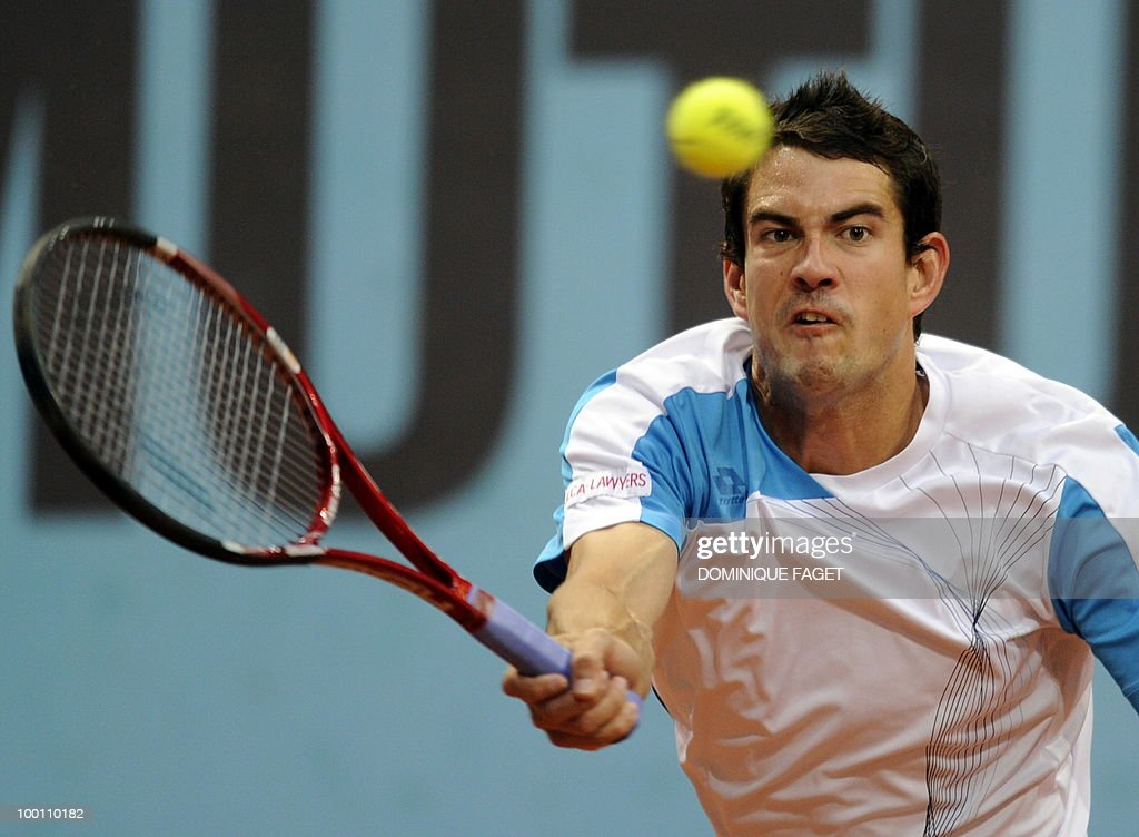 Spanish Guillermo Garcia-Lopez returns the ball to French Jo-Wilfried Tsonga during their match of the Madrid Masters on May 12, 2010 at the Caja Magic sports complex in Madrid.