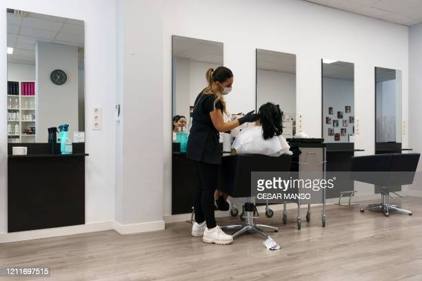Spanish hairdresser Virginia attends her first client after reopening her salon in Burgos, on May 4 for the first time since the beginning of a...