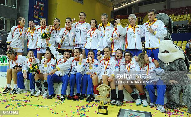 Spanish handball team members pose as they celebrate their silver medal on the podium of the 8th Women's Handball European Championships on December...