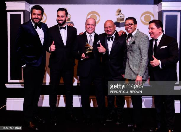 Spanish Harlem Orchestra pose in the press room for the Best Tropical Latin Album Anniversary during the 61st Annual Grammy Awards on February 10 in...