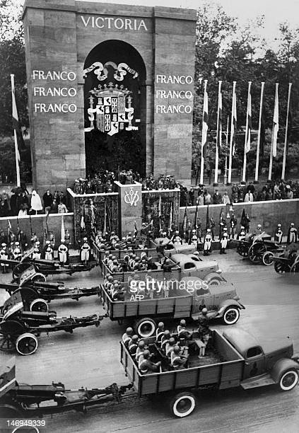 Spanish Head of State Francisco Franco presides the first victory parade after the end of the Spanish Civil War in Madrid on May 19 while members of...