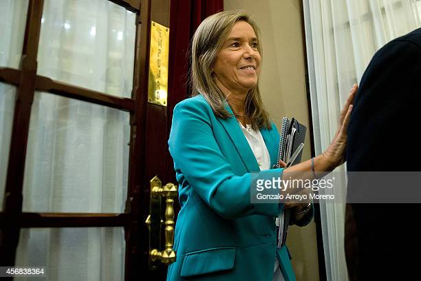 Spanish Health Minister Ana Mato leaves the Spanish Parliament camera behind a party mate on October 8 2014 in Madrid Spain Spanish Health Minister...