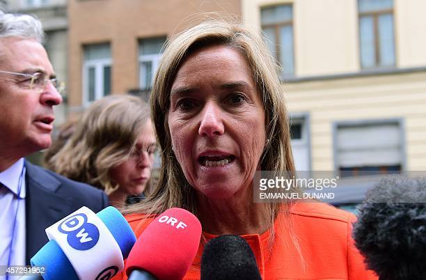 Spanish Health Minister Ana Mato speaks to journalists as she arrives to attend a ministerial meeting on EU public health measures on the Ebola...