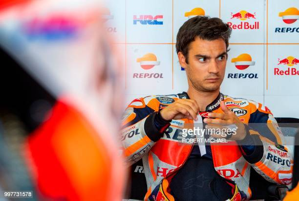 Spanish Honda rider Dani Pedrosa prepares in the box prior to the second training session of the Moto GP for the Grand Prix of Germany at the...