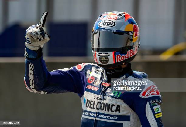 Spanish Honda rider Jorge Martin celebrates after winning the Moto3 race at the Grand Prix of Germany at the Sachsenring Circuit on July 15 2018 in...