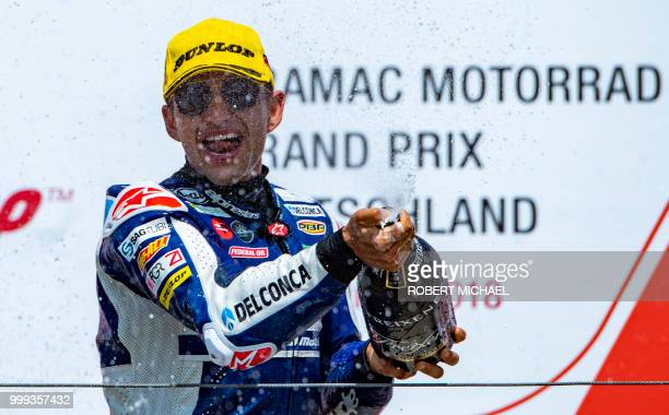 Spanish Honda rider Jorge Martin celebrates on the podium after winning the Moto3 race at the Grand Prix of Germany at the Sachsenring Circuit on...