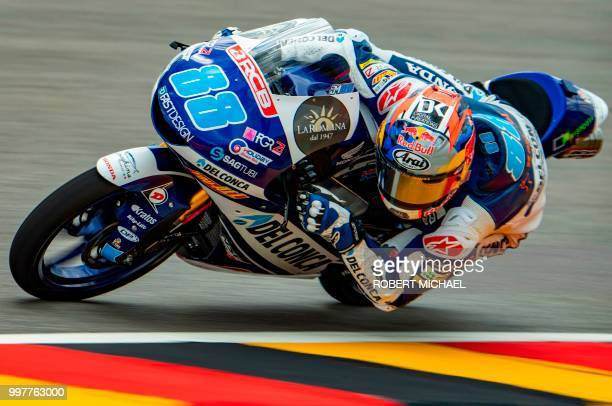 Spanish Honda rider Jorge Martin steers his bike during the second training session of the Moto3 for the Grand Prix of Germany at the Sachsenring...