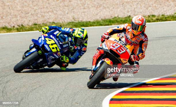TOPSHOT Spanish Honda rider Marc Marquez and Italian Yamaha rider Valentino Rossi compete in the training session of the Moto GP for the Grand Prix...
