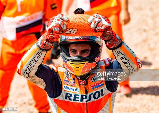 TOPSHOT Spanish Honda rider Marc Marquez celebrates after winning the Moto GP race at the Grand Prix of Germany at the Sachsenring Circuit on July 15...