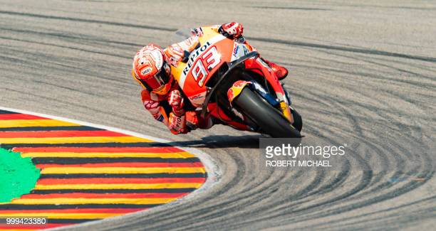 Spanish Honda rider Marc Marquez competes to win the Moto GP race at the Grand Prix of Germany at the Sachsenring Circuit on July 15 2018 in...
