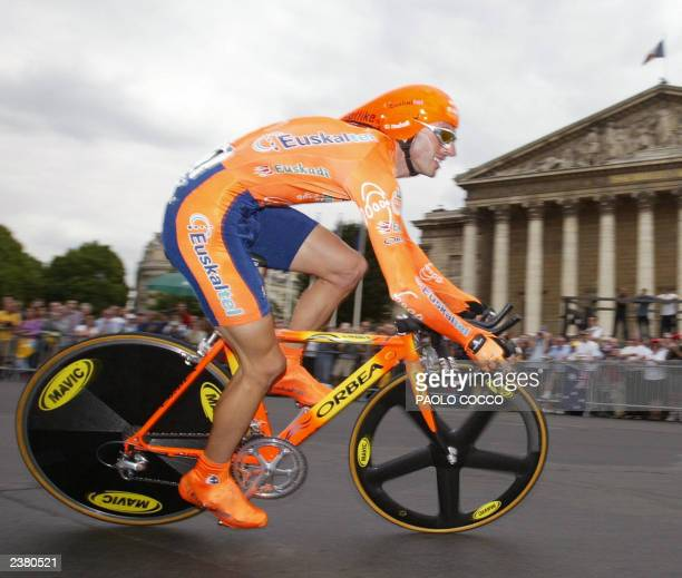 Spanish Iban Mayo takes a curve in front of the National Assembly during the prologue of the 90th Tour de France a time trial in Paris 05 July 2003...